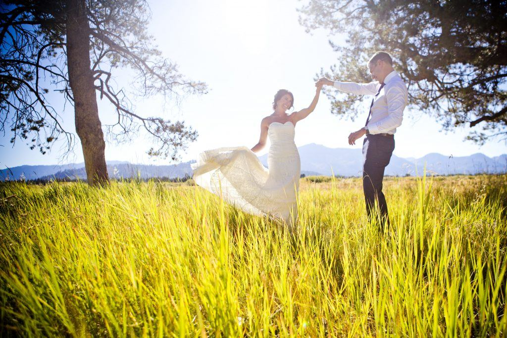 bride and groom in field of long grass