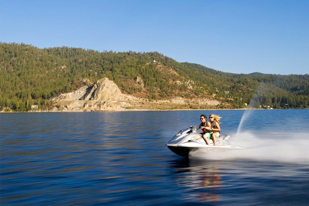 couple jet skiing on lake tahoe