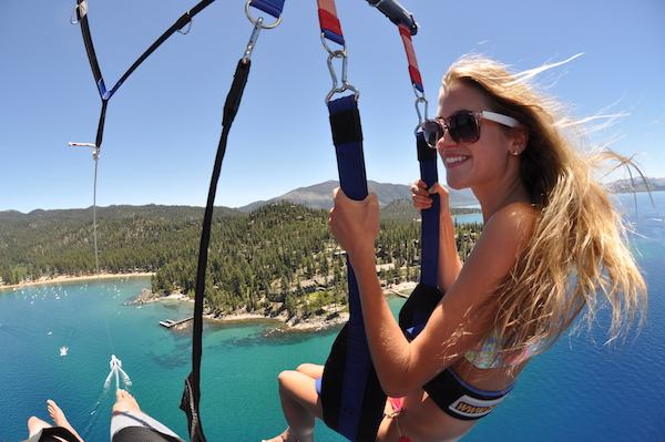 You just took the big leap with your main squeeze. Let your adventurous side loose with a parasailing tour of the lake! Photo Credit: Zephyr Cove Resort