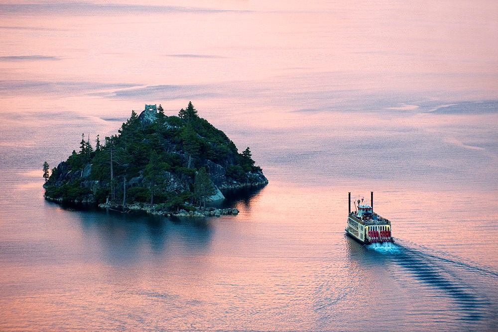 Paddle wheeler in Emerald Bay at sunset.