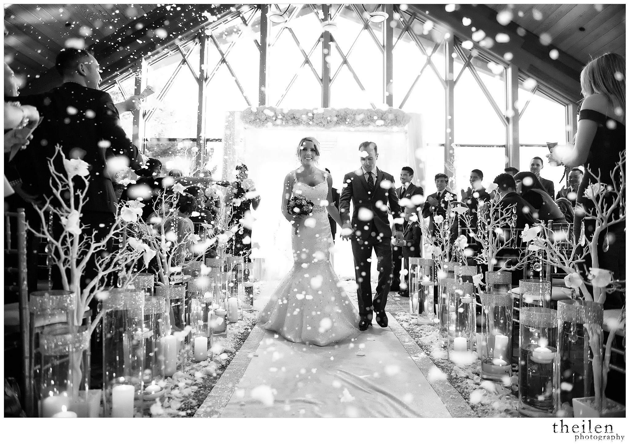 snow falling on a newlywed couple