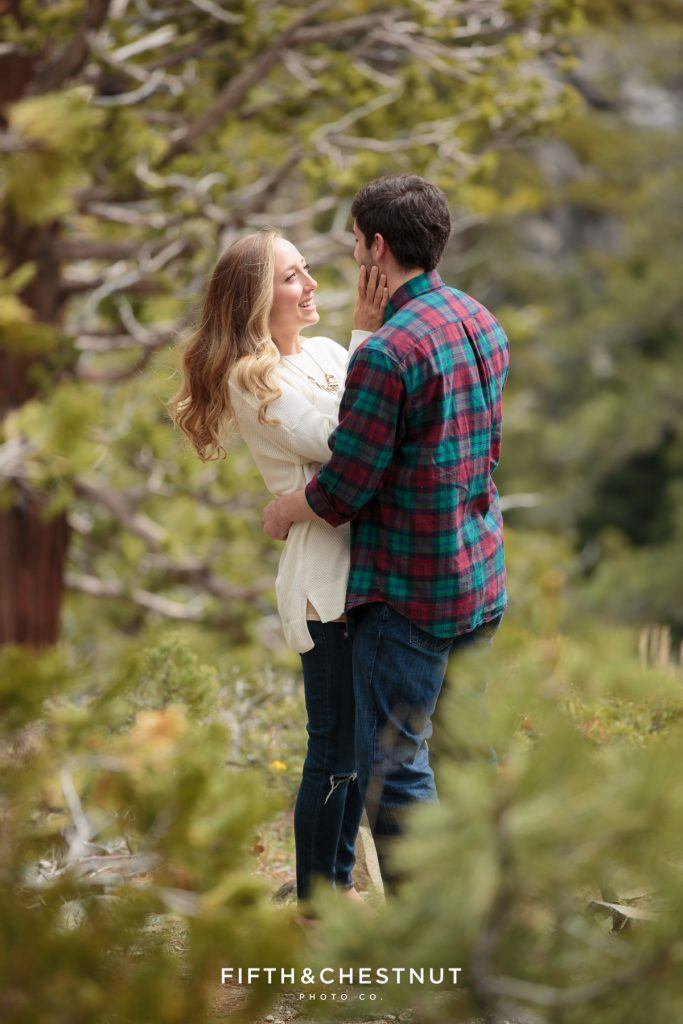 An intimate Tahoe wedding proposal surrounded by tall pines. Photo Credit: Fifth & Chestnut