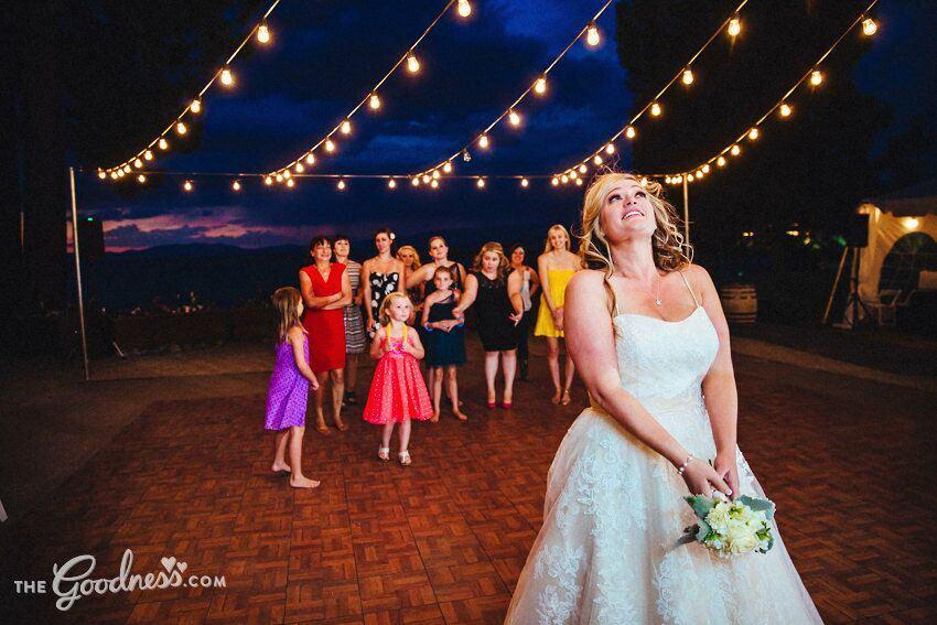 mountain wedding at night bouquet toss