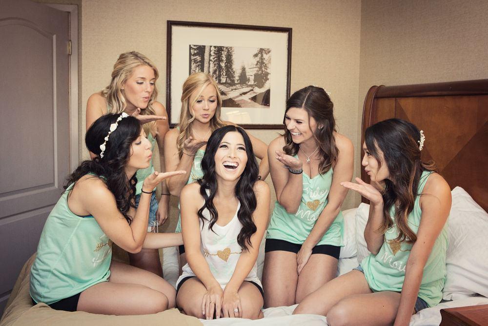 bride and bridesmaids posing in their lake tahoe resort hotel room