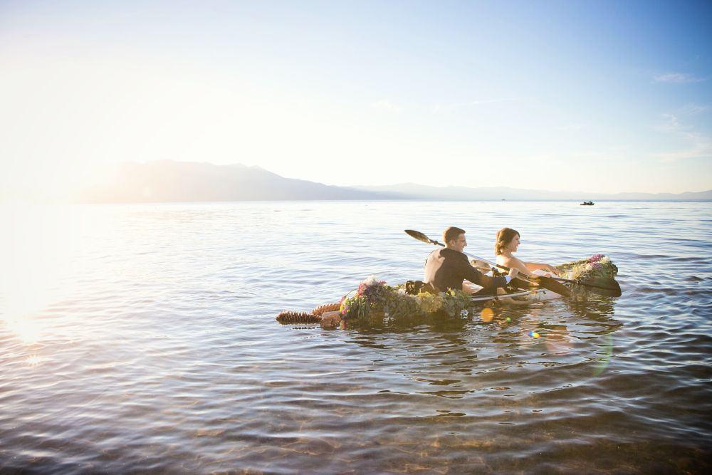 bride and groom in kayak on lake tahoe