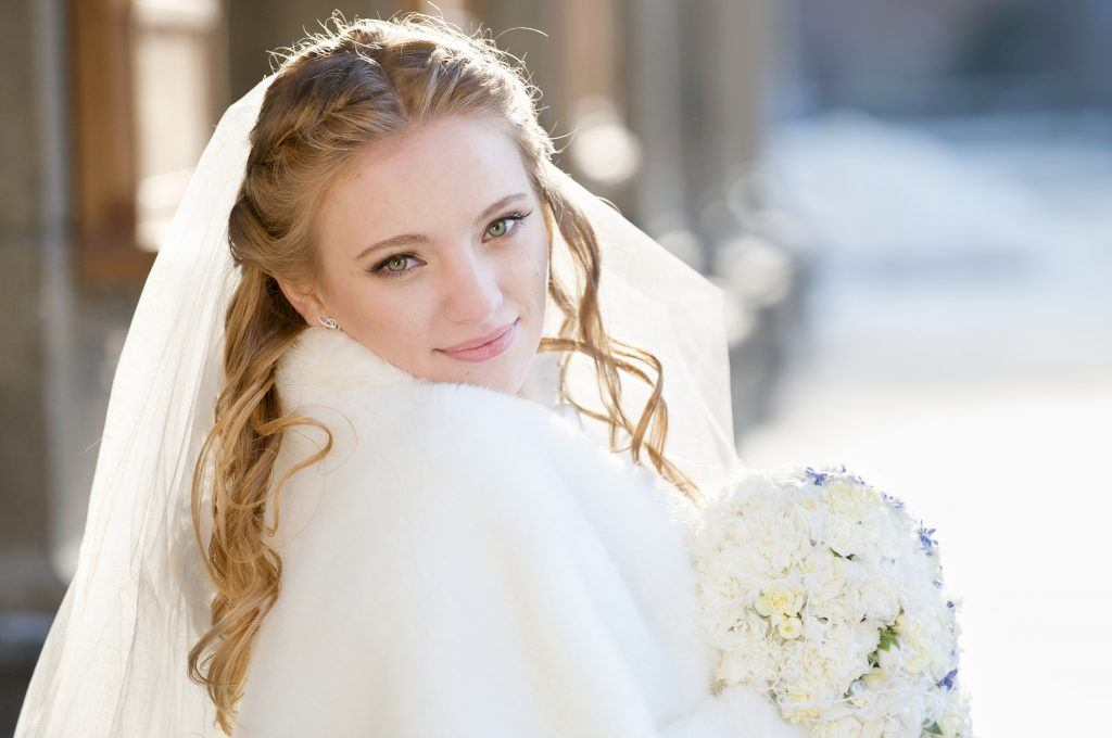 winter bride with blonde hair and green eyes