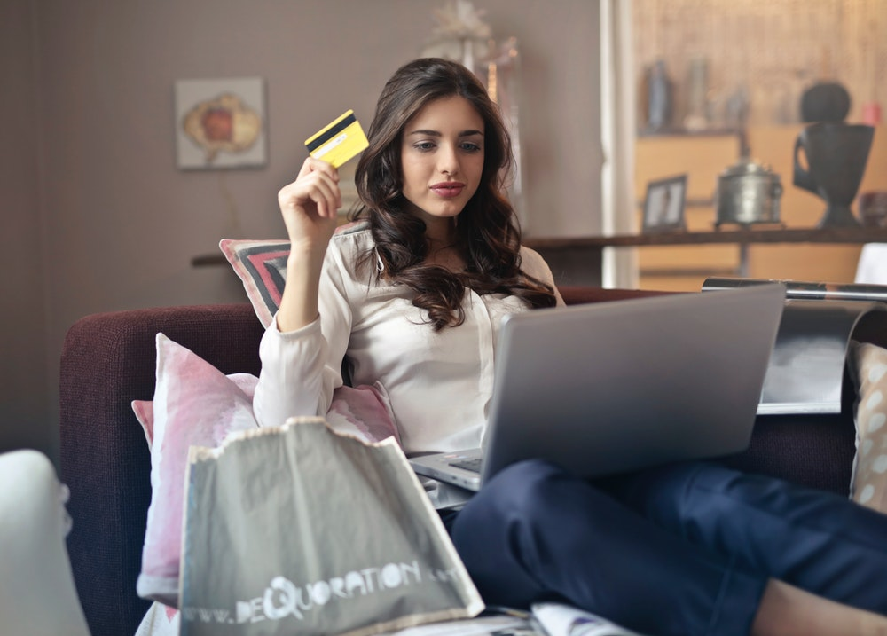 woman shopping online using a credit card