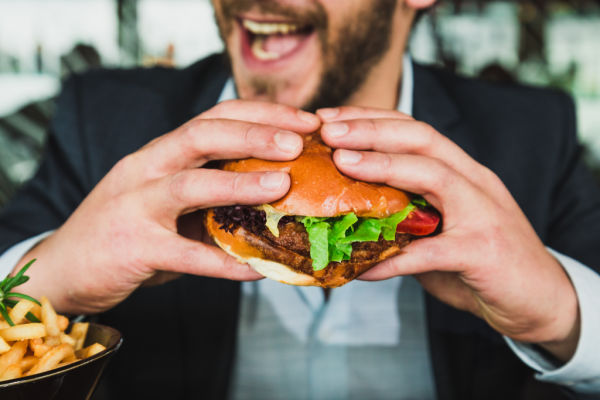 happy man eating a burger