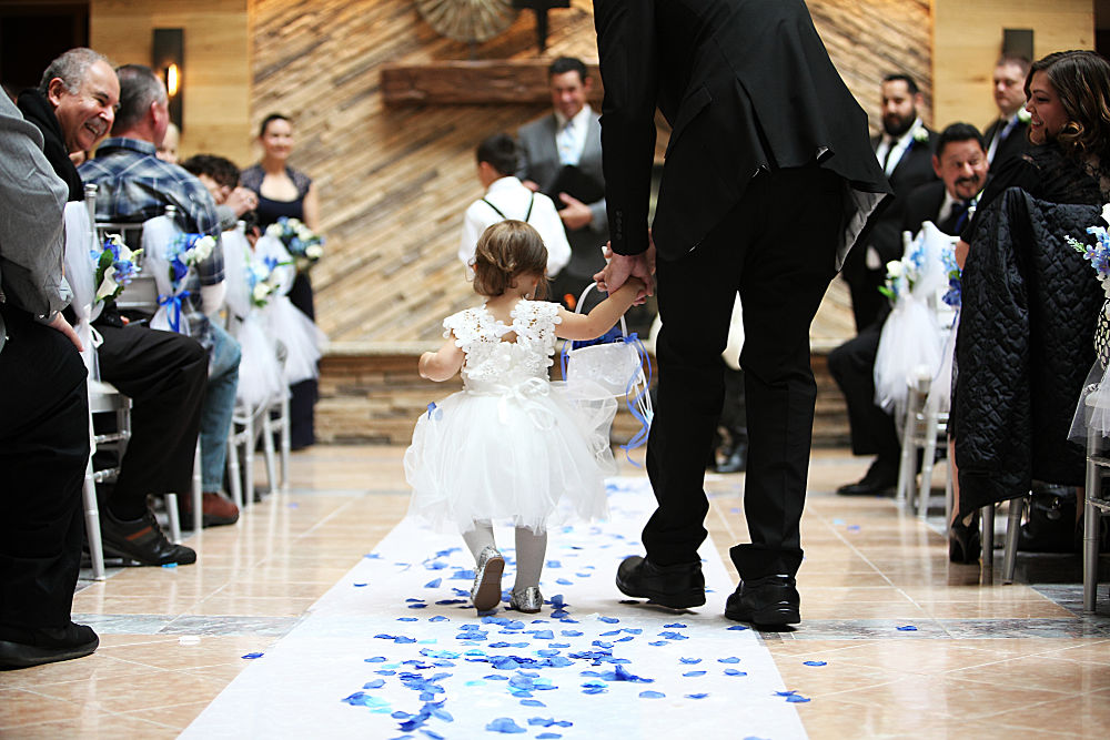 flower girl walking up the aisle