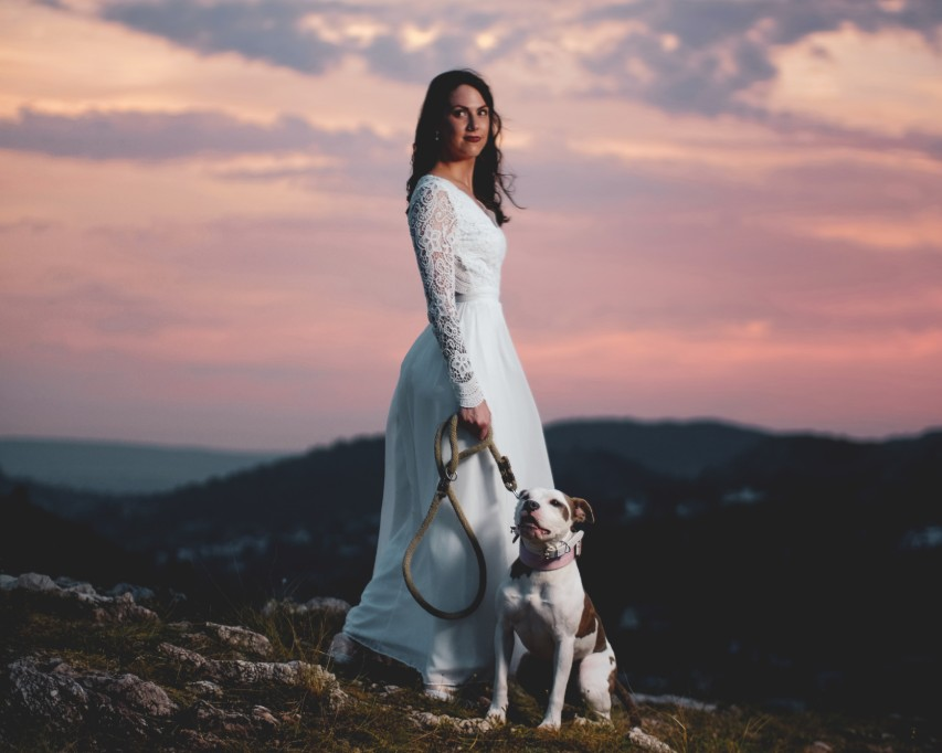 bride posing with dog