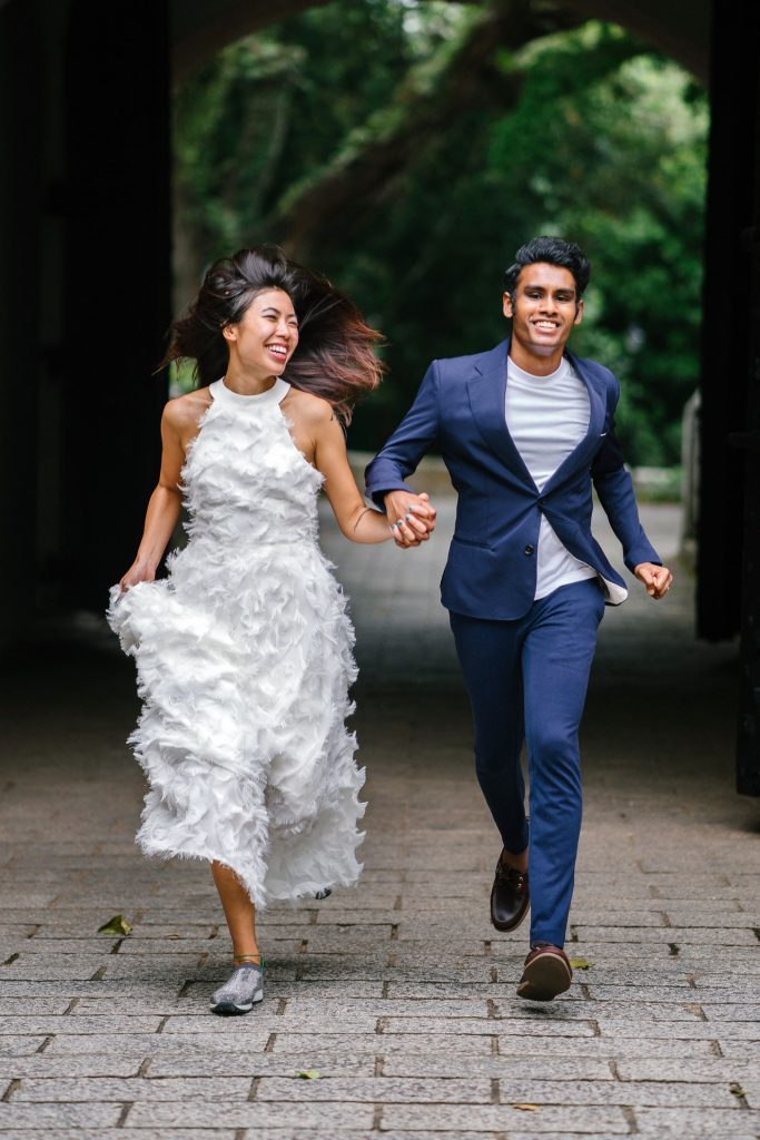 bride and groom running toward the camera