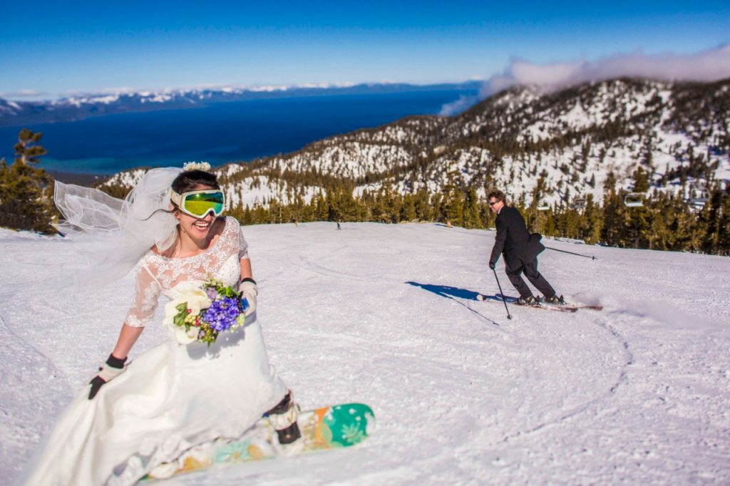 bride and groom snowboarding and skiing