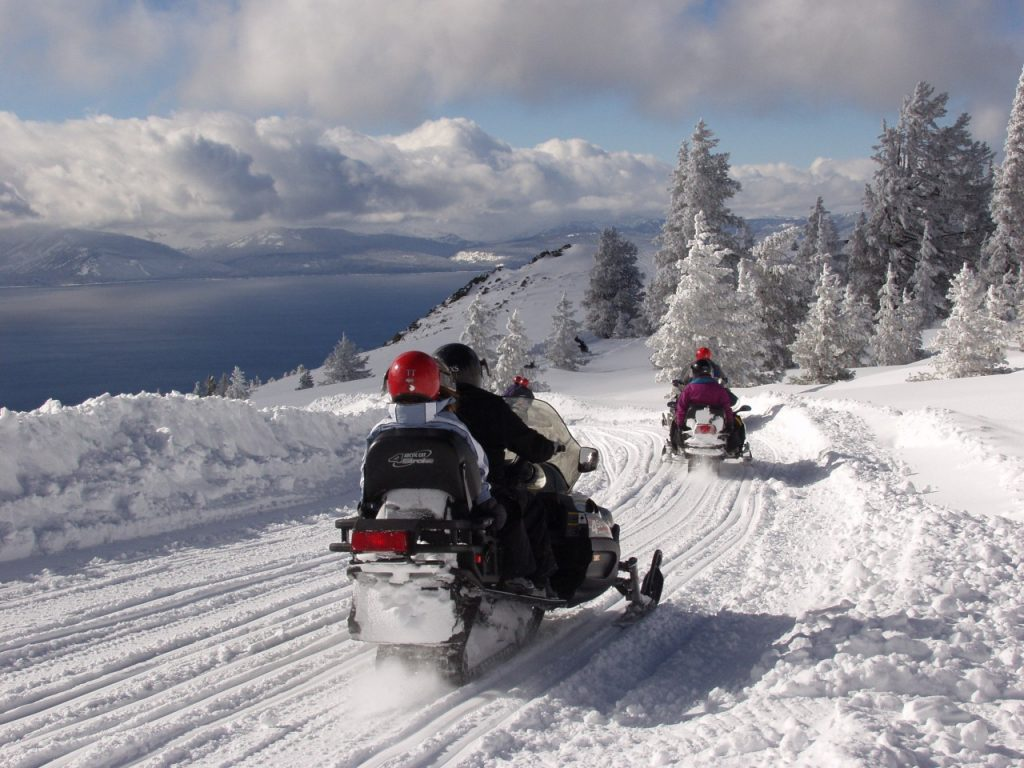 Group of friends snowmobiling in Tahoe South